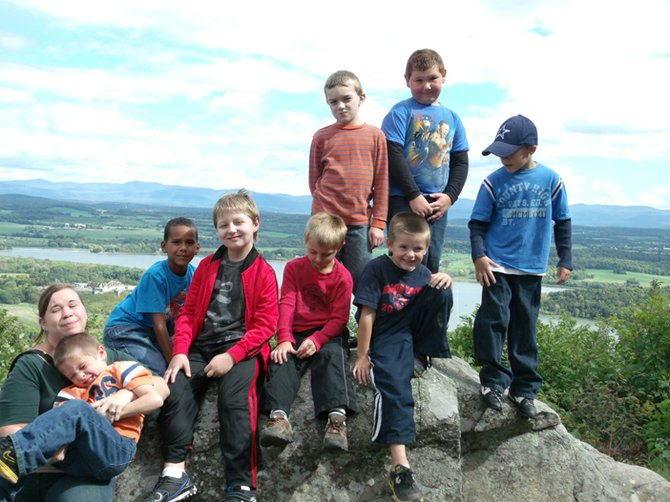 Hague Cub Scout Pack 73 stands atop Mt. Defiance in Ticonderoga. Pictured are Kishia Patneude, Carter Thatcher, Michael Wilson, Amadeus Jordon, Tyler Russell, Hunter Borden, Ashton Warren, Kaleb Gijanto and Bryce Porter.