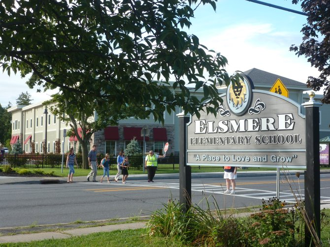 Town officials, along with parents and staff of Elsmere Elementary, met to discuss crosswalk safety improvements for students.
