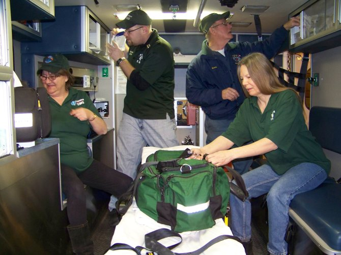 Checking their ambulance's inventory of supplies and equipment Tuesday Feb. 5 are Thurman EMS volunteers (clockwise, from left): Becky Desourdy, Acting Thurman EMS Captain Josh Hayes, Ernie Smith and squad treasurer Debbie Runyon.