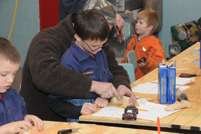 Cub Scouts from throughout the region were busy creating their Pinewood Derby cars during the annual Derby Night at the Champlain Valley Transportation Museum and Kids Station Jan. 11.