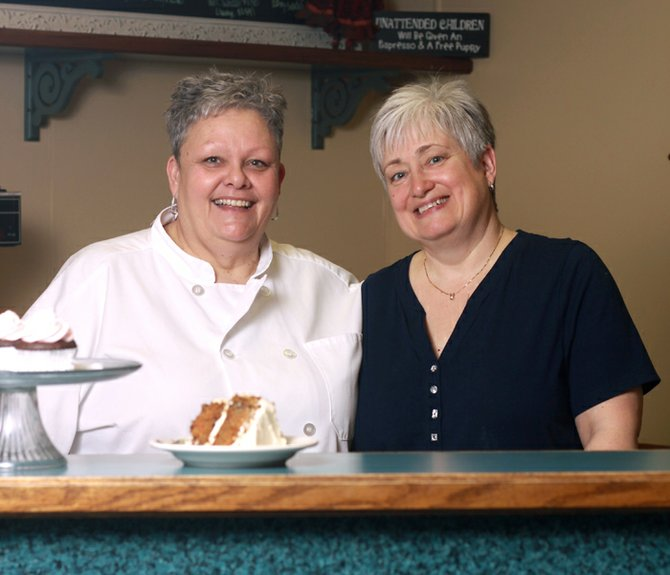 "Barb Wright and Kay Crawford stand inside their new business, Latté Da! Café & Bakehouse, located on 3 Linklaen St. in Cazenovia. The business duo is featured in the ""Platter Chatter"" section of the February 2013 edition of Syracuse Woman Magazine."