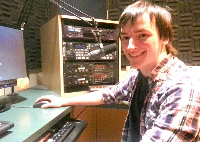 Chris Steinberger sits in an editing suite at Onondaga Community College.