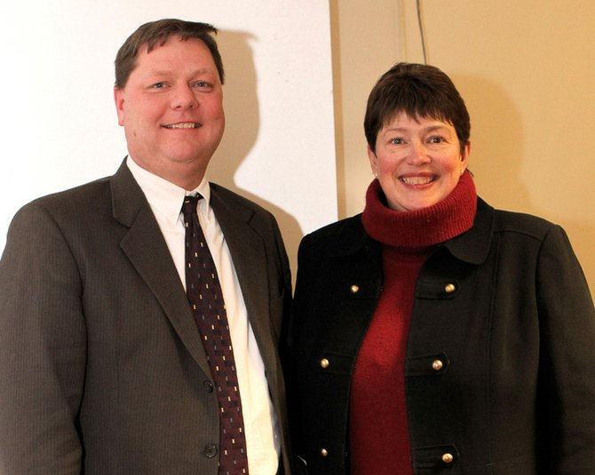 Ticonderoga Central School Superintendent John McDonald visits with Dede Scozzafava, deputy secretary of state for local government, while she was in Ticonderoga to make a state budget presentation. McDonald urged Scozzafava to press state officials to help the rural poor.