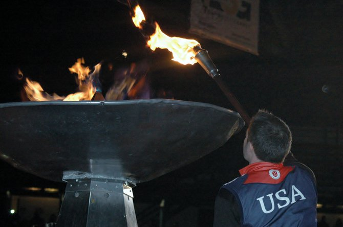 "Paralympian Augustus ""Goose"" Perez lights the Empire State Winter Games Cauldron Feb. 7 in Lake Placid."