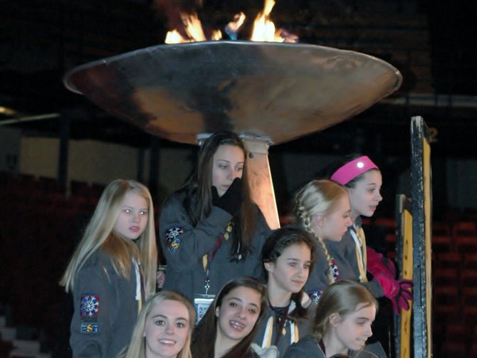Athletes pose in front of the Empire State Games cauldron during the opening ceremonies Feb. 7.