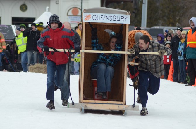 A team of employees from Queensbury Home Depot run towards the finish line in the annual outhouse race held by Lake George Winter Carnival Saturday Feb. 2. This weekend, such zany action will be featured again upcounty, as the first-ever Brant Lake Winter Carnival will be holding an outhouse race among its many family-friendly activities for not only spectators but participants.