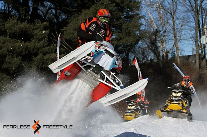 Snowmobile racer Mike Pilotte goes airborne during a race held by East Coast Snocross in Lake George in late January. Top snocross racers from the U.S. and Canada are expected to compete in a repeat appearance in Lake George this weekend.