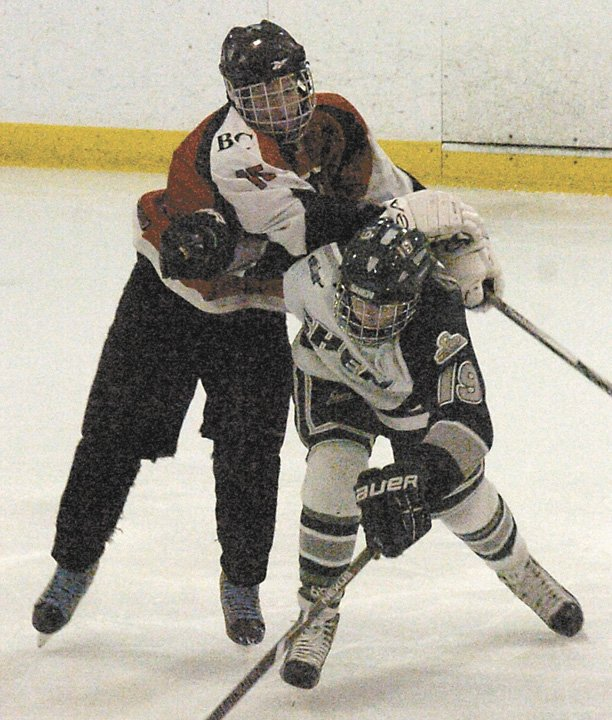 Bethlehem's Nicholas Gosstola battles with Shenendehowa's Peter Russo during a Feb. 7 CDHSHL game at the Clifton Park Arena.