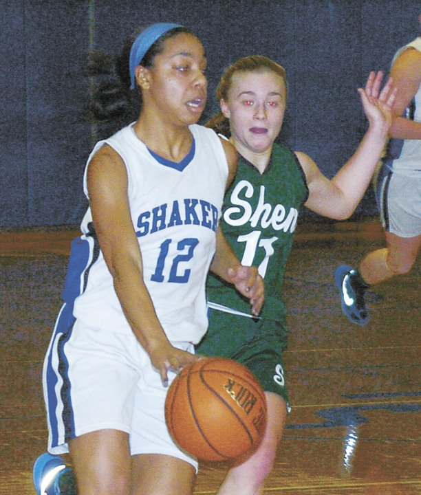 Shakers Madison Rowland drives past Shenendehowas Kristen Connors during the second quarter of a Feb. 9 Suburban Council North Division game.