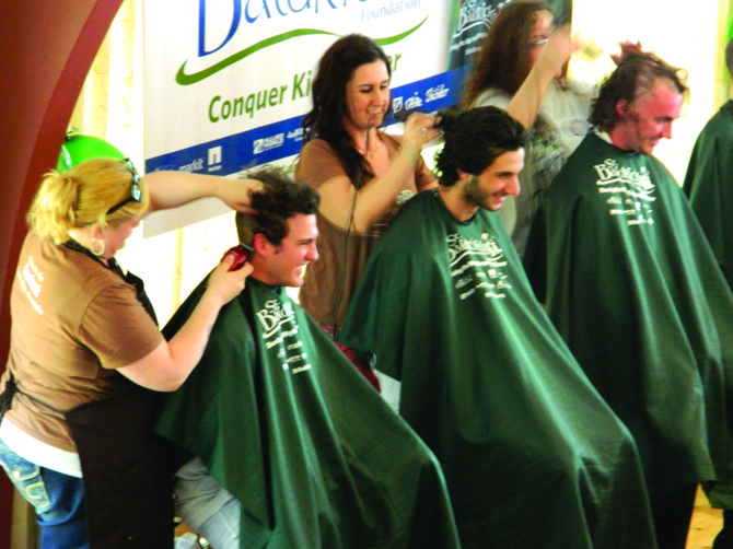 Volunteers get their heads shaved at last year&#39;s St. Baldrick&#39;s charity event at St. James&#39; church in Skaneateles. 