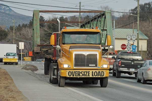 The Otis Bridge makes its way through Elizabethtown Feb. 7, heading toward the Essex County Fairgrounds in Westport. The bridge was removed from Otis Lane in New Russia two days prior and moved to the Essex County Public Safety Building before being transported to the fairgrounds.