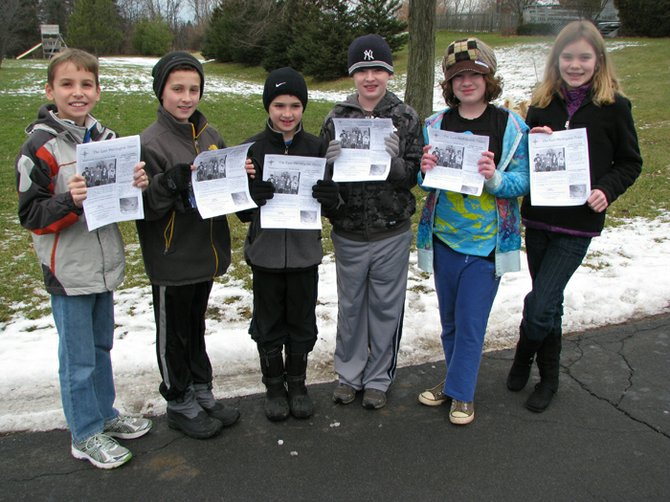 The staff of the East Wellington Times posed in 2012 with the first issue of their monthly newsletter. Justin LaBarre, left, Zachary Simms, Aidan Simms, Judd Spaulding, Libby Spaulding and Savannah Johnson delivered the first 40 issues to residents Saturday, Jan. 7. Since then, a new staff member, Chad Carges, not pictured, has been added and distribution is nearly 50 copies every month. The publication includes interviews, photos, weekly columns and seriealized fiction.