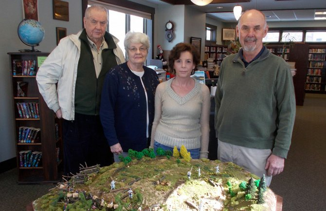 A model of the Battle of Carillon has been placed at the Carnegie Street entrance to the Black Watch Memorial Library. From left are John McDonald Sr., library trustee, Denise Huestis, who constructed the model, Heather Johns, senior library clerk, and Steve Boyce, library trustee.