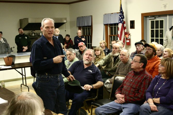 Thurman-based contractor Mike Eddy, backed up by about 100 townspeople, confronts the Thurman Town Board Feb. 12,  calling for the town government to financially support Thurmans independent ambulance squad. A proposition to appropriate $62,000 to the squad for 2013 was defeated by the board by a 2-3 vote.