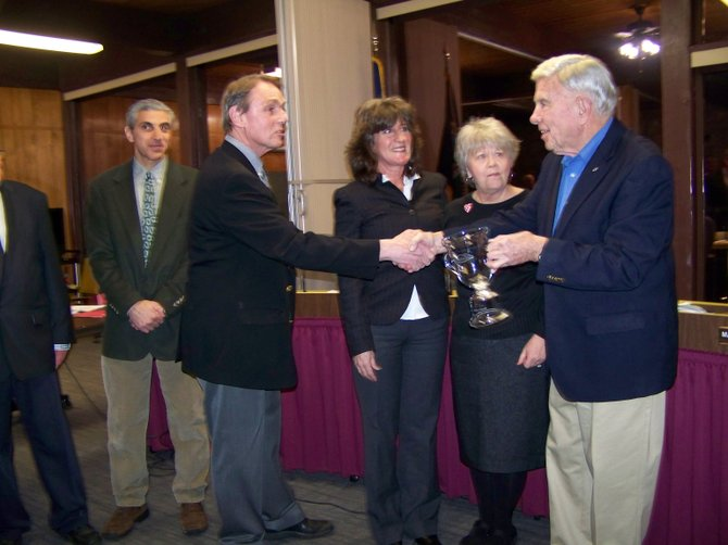 Lake George Supervisor Dennis Dickinson (front, left)  presents the first annual Lake George Community Stewardship Award to Denny Galloway at a town meeting Feb. 11. Participating in the presentation are: (rear, left to right): town board members Vinnie Crocitto, Fran Heinrich and Marisa Muratori. (Not shown: town board member Dan Hurley.)