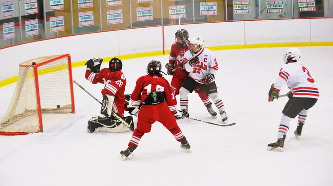 Baldwinsville forwared Garth Gray (3) sees his shot from the point elude Central Square goaltender Keegan Murphy (29) in Thursday night's Division I quarterfinal. Gray also had three assists in the Bees' 8-2 victory over the Red Hawks.