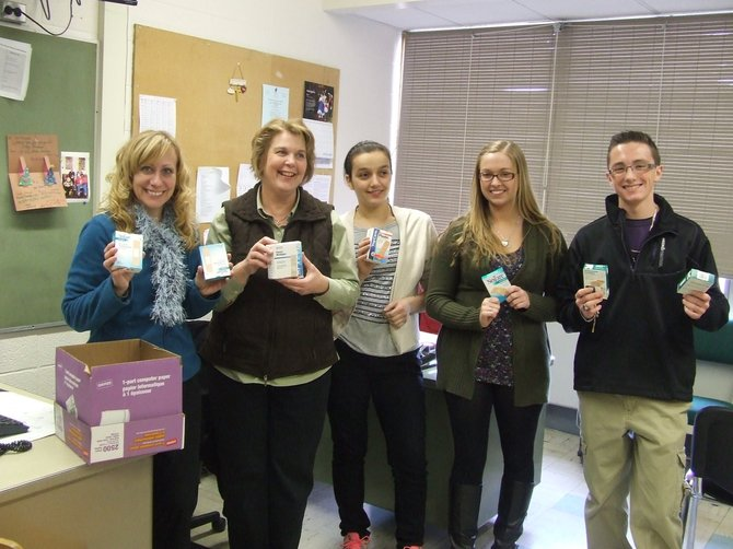 Colonie High School Key Club members donated more than 200 boxes of band-aids to the health office. Nurses, like so many others in the school district, are feeling the hardships of budget cuts, loss of state aid and the 2 percent tax cap.