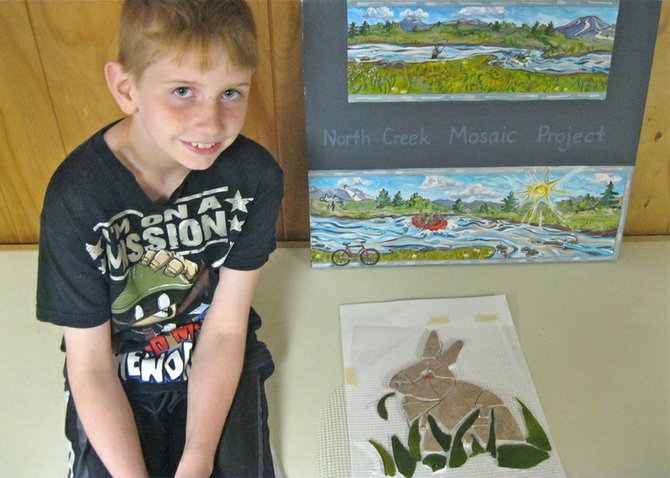 In 2012, several Cub Scouts from Pack 36 in North Creek attended a mosaic workshop to create elements for the North Creek Mosaic Project. This tile rabbit munching on leaves, by Anthony Galle, was installed on the second panel of the large community mural, on Main Street.