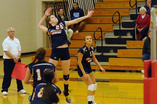 East Syracuse-Minoa hitter Rachel Aird (25) goes up for a spike attempt in Saturday night's Section III Class A final against Whitesboro. Aird had 13 kills and seven blocks as the Spartans lost in four sets to the Warriors.