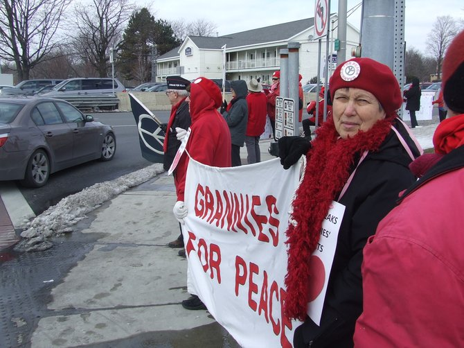 On Valentine's Day, more than 20 grannies and grandpas stood at the busy intersection of Wolf Road and Central Avenue for a vigil calling for an end to gun violence, both in wartime and domestically.