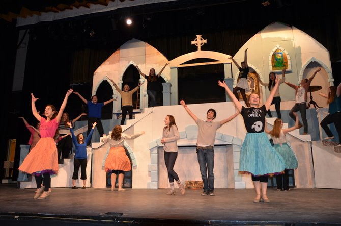 "The cast of Skaneateles High School Drama Club's upcoming ""Beauty and the Beast"" rehearse the musical number ""Be Our Guest."""