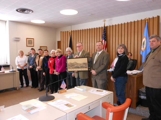 Among those participating in the Feb. 15 recognition of Warrensburg's bicenntennial, were town citizens and officials (left to right):  deputy town clerks Gail Olden and Kathy Rounds, town Historian Sandi Parisi, Peggy Knowles, Ruth Fruda, Town Clerk Donna Combs, Warrensburg Chamber President Lynn Smith, Warrensburg Supervisor Kevin Geraghty, Town Councilman Bryan Rounds, town Beautification Committee founder Teresa Whalen, and town Deputy Supervisor John Alexander.
