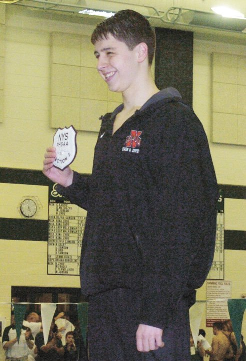 Niskayuna's Emerson Wells holds his championship patch after winning the 500-yard freestyle title at last Saturday's Section II Division I meet at the Shenendehowa Aquatic Center. Wells also swam on the Silver Warriors' winning 400-yard freestyle relay team.
