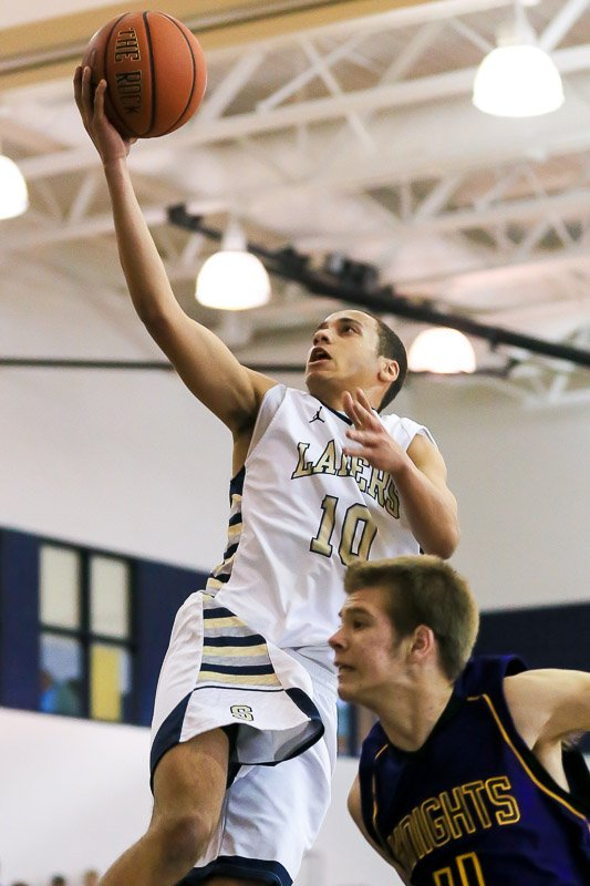 Skaneateles guard Collin Jones (10) floats to the basket for a close-up shot during Wednesday afternoon's Class B quarterfinal against Holland Patent. Jones had 10 points as the Lakers eliminated the Golden Knights 72-44.