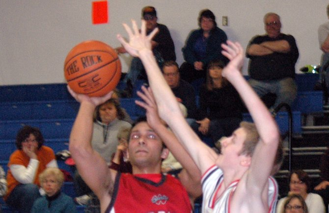 Brandon Porter of Willsboro, in red, goes up for a shot against Anderson Gay of Westport during the opening round of the Section VII/Class D playoffs Feb. 20.