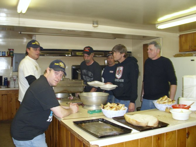 Volunteering in the kitchen at the Warrensburg PTSA's recent spaghetti dinner fundraiser are V.F.W. 4821 Auxiliary members (clockwise from front): Eddie Bates, Larry Crandall, Monty Fish, Gregg Fish, Jim Brainard and Paul Baird.