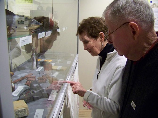 Inspecting artifacts at the Warrensburg Museum of Local History Sunday Feb. 17 are town residents Bob and Peggy Knowles. They were among dozens who attended the opening of the museum's extensive new Warrensburg Bicentennial exhibit that showcases the developments and activities in town over the last 200 years.