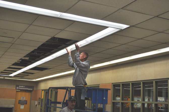 Over the past six weeks, the Albany County Airport Authority has been working on a new project to replace its 15-year-old lightning fixtures in the airport's terminals with brand new, high efficiency LED and florescent bulbs.