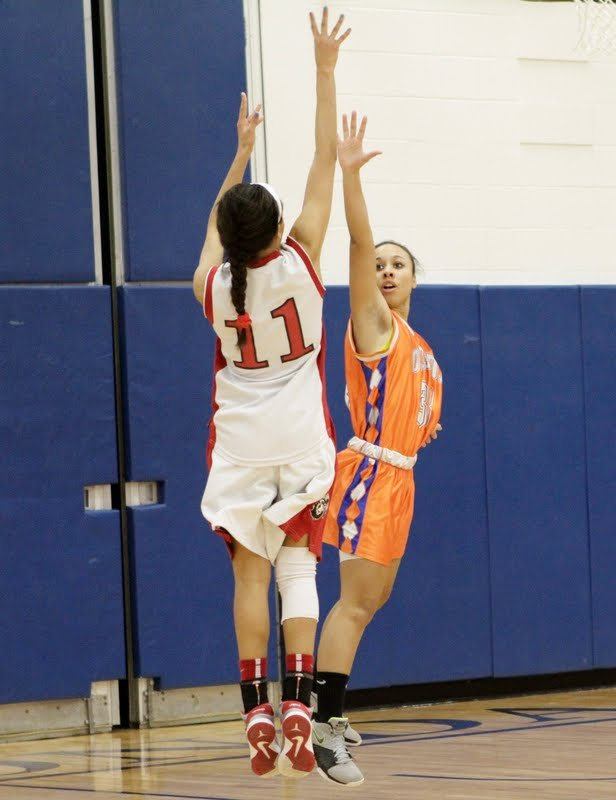 Jamesville-DeWitt guard Arriell Mussi (11) goes up for a jump shot over an Oneida defender in Friday night's Class A semifinal at Onondaga Community College's Allyn Hall. Mussi led the Red Rams to a 49-32 victory and a berth in next Wednesday's sectional final against Whitesboro in the Carrier Dome.