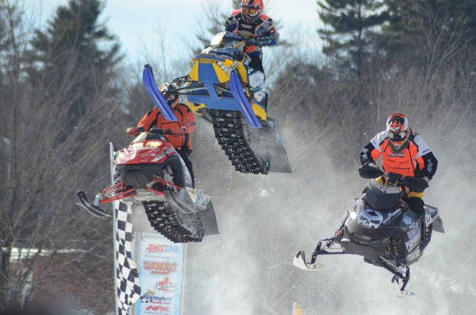 Snowmobile racers go airborne during a race held by East Coast Snocross recently in conjunction with the Lake George Winter Carnival. Top snocross racers from the U.S. and Canada competed over two days in the series of sanctioned snowmobile races. The 2013 edition of the Winter Carnival, to be held Saturday Feb. 23 and Sunday Feb. 24, will be featuring a long list of family-friendly events, although the sports car ice races have been cancelled due to the lake ice not attaining the minimum thickness for motor vehicle racing.