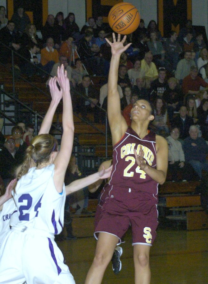 Colonie's Sydnie Rosales shoots over two Catholic Central defenders during Friday's Section II Class AA quarterfinal game at Bethlehem Central High School.