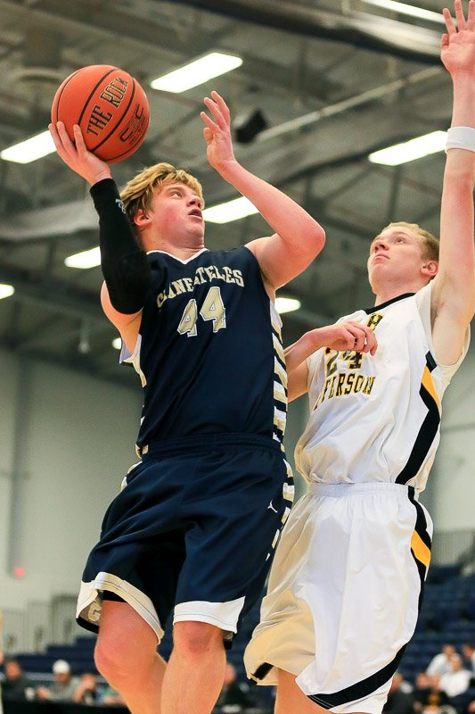 Skaneateles junior forward Chris Knupp (44) leans in over South Jefferson's William Beese (24) to take a shot in Sunday's Class B semifinal. Knupp led his team with 21 points as the Lakers rallied to beat the top-seeded Spartans 58-52 in overtime.