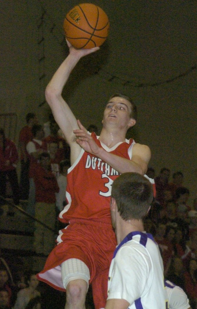 Guilderland's Brian Crupi soars in for a shot during Saturday's Section II Class AA quarterfinal game against Christian Brothers Academy at Hudson Valley Community College.