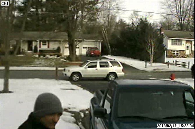 State Police are looking for this man, bottom left, who allegedly appeared at the front door of a Clifton Park resident and hit him in the head with a metal pipe. The suspect's car appears in the background.