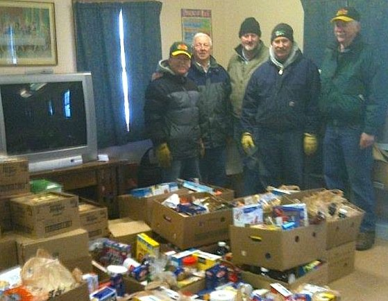 Vergennes Lions Club members Gary Russell, Larry Simino, Jim McClay, Bruce Bushey, and Mel Simmons stand behind their work, which was collecting 41 boxes of edible products for the Bristol Food Shelf located at the Shaw's Supermarket in downtown Bristol.