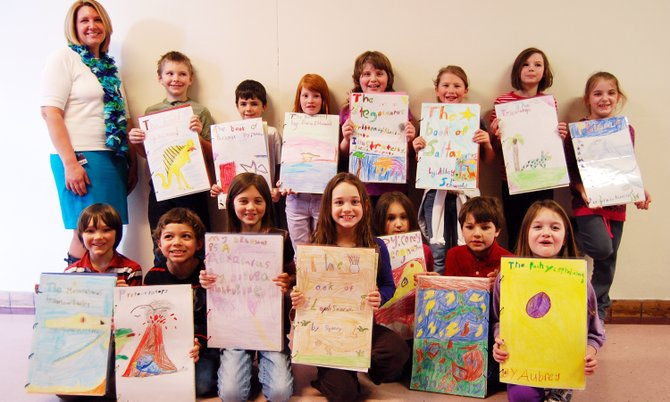 Lynn Bubbins second grade class displays their dinosaur books they wrote and illustrated at their book party on Feb. 15.