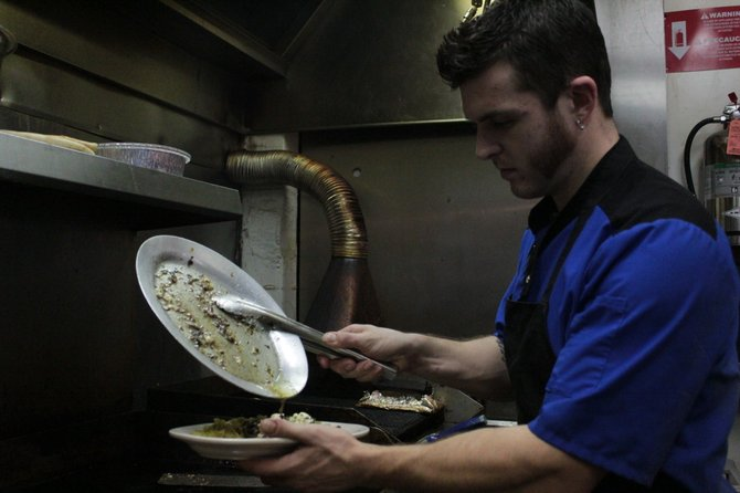 Aleka's-Tyler Puchrik, head chef at Aleka's in downtown Plattsburgh, plates a Greek steak.