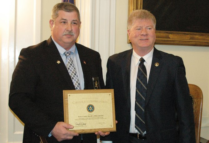 Essex County Sheriff Richard Cutting, left, receives a certificate of appreciation from U.S. Marshal David Demag.