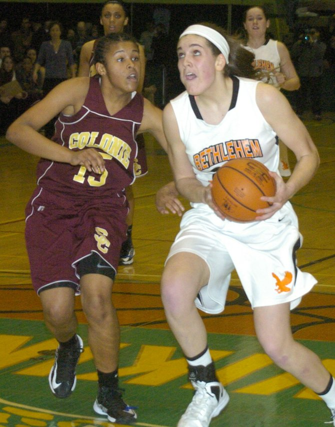 Bethlehem&#39;s Gabby Giacone drives past Colonie&#39;s Nicole Riddick during Wednesday&#39;s Section II Class AA semifinal game at Hudson Valley Community College.