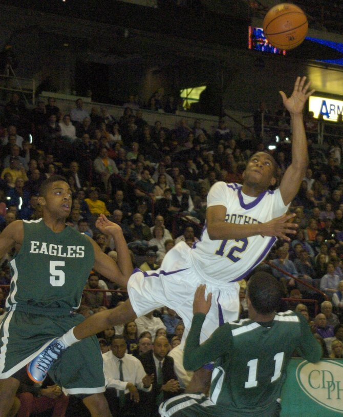 CBA's Tyrell Ramsey takes a difficult shot in traffic during Thursday's Section II Class AA semifinal game against Green Tech at the Times Union Center.