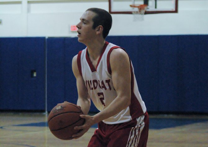 Tanner Stone lines up a three-point shot for Schroon Lake.