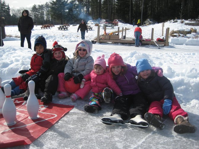 Bolton-area youngsters take a break after ice skating at Bolton's Winter Break Party on Saturday Feb. 23. The event, held at the Bolton Conservation Club, featured an array of winter outdoor activities.