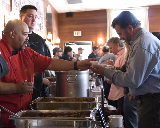 Chefs from area restaurants dish out servings of their distinctive varieties of chili during the 2012 Bands 'N Beans event — sponsored by the Lake George Arts Project.