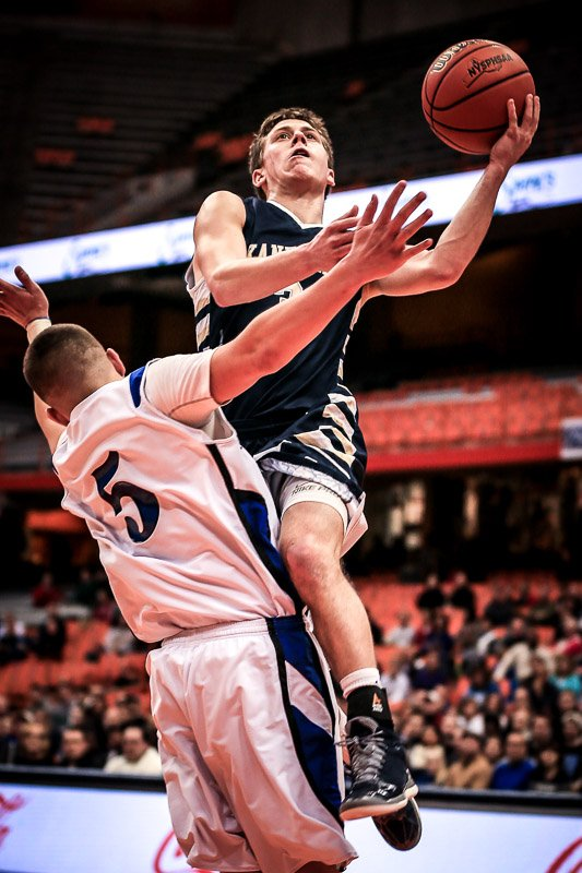 Skaneateles guard Alex Brownlee (3) soars above Westhill's Dan Gratien (5) to take a shot in Sunday's Section III Class B final at the Carrier Dome. Despite 16 points from Brownlee and a frantic second-half comeback, the Lakers lost, 63-51, to the Warriors.