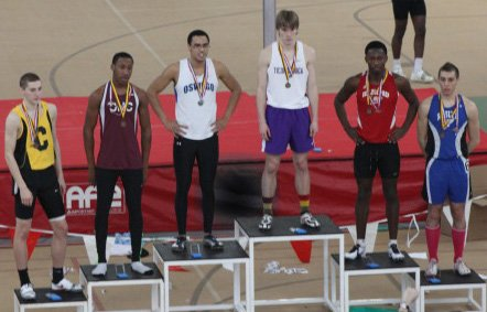 Jay Hebert, third from the right, receives his championship medals at the New York State Public High School Athletic Association indoor track championships March 2. Following the meet the 55-meter hurdle specialist learned he had become the top athlete in his event in the nation.