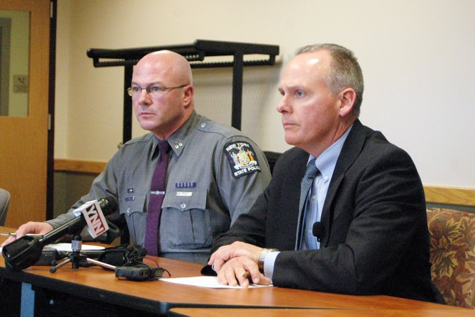 New York State Police Zone Commander John Tibbitts and BCI Capt. Robert LaFountain brief members of the media on a shooting incident in the town of North Hudson March 5.